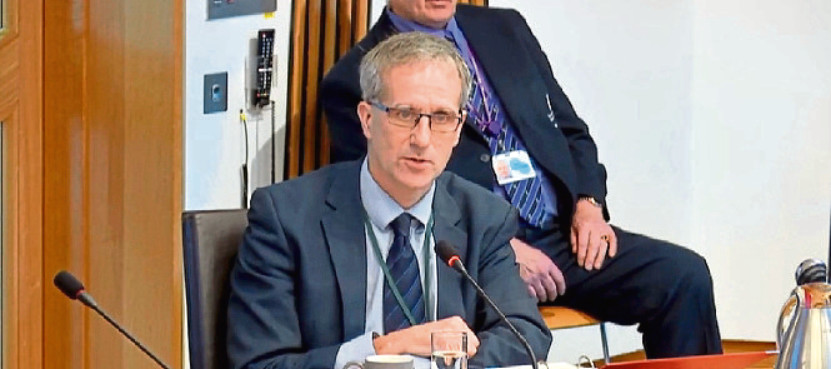 Alan Gray, director of finance for NHS Grampian speaking during Tuesday's Health and Sport Committee