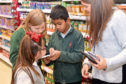 The Westhill Primary schoolchildren staging their supermarket sweep in Tesco, which was donated to CFINE