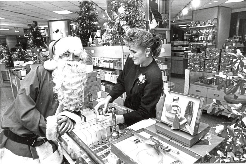 1989: Santa gets some beauty advice from House of Fraser's Estee Lauder consultant Carol Laurie