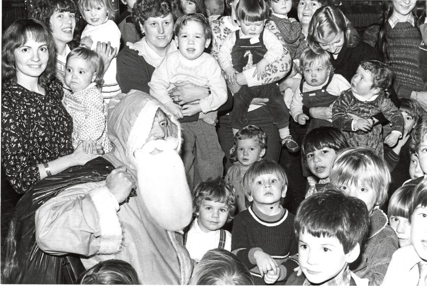 1982: Santa spreads Christmas cheer among youngsters at the Aberdeen University's children's Christmas party