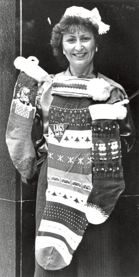 1987: Norma Mitchell is hoping for lots of presents to fill her stockings