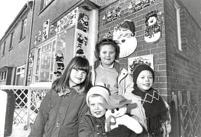 1990: Grandchildren of Ina Smith outside her Santa-covered house at Fernielea Crescent, Aberdeen