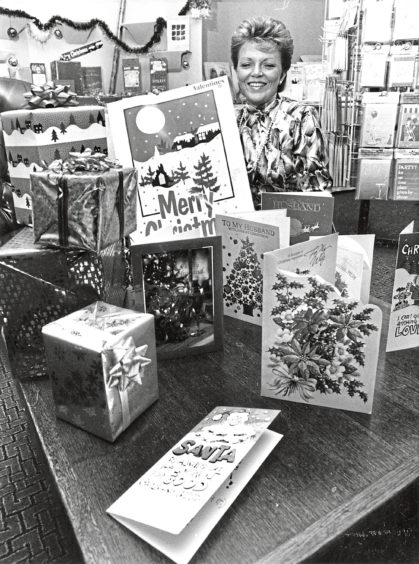 1988: Ann Farrall is showing retailers in Aberdeen some of the Christmas cards and wrapping paper made by the company Valentine for next year's Christmas