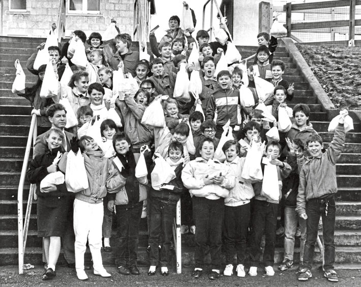 1987: Christmas food parcels were delivered to pensioners living in the Linksfield Academy area by some of the school's first year pupils. The delivery operation was organised by assistant head teacher Peter Keith, front left