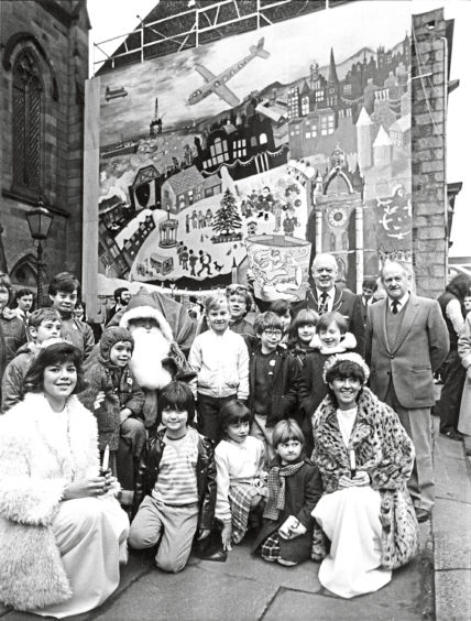1984: Children gather round Santa at the official opening of the giant advent calendar at Langstane Kirk