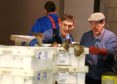 Workers at Peterhead fish market prepare boxes of fish for sale