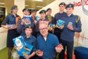 The cadets handing over goods and, below, Fiona Rae of CFINE with more donated items