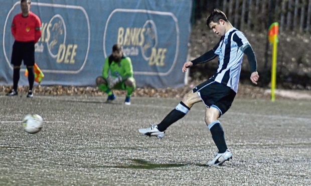 Fraserburgh's Willie West scores a penalty in cup action against Banks o' Dee for Fraserburgh.
