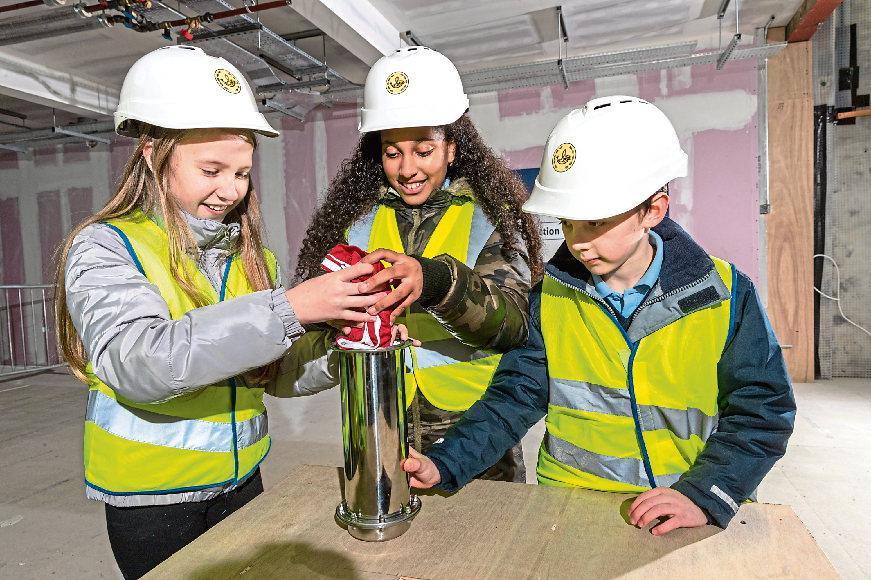 Oliwia Prokopowicz (P7), Mara Coelho (P6) and Fraser Murphy (P5) from St Peters Primary School helped fill the time capsule.