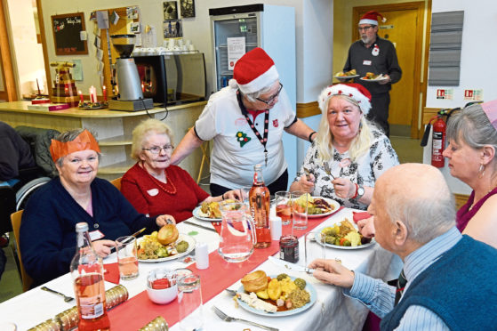 Pictured is the annual Christmas Dinner service for the needy at the Salvation Army, Aberdeen Citadel, Aberdeen