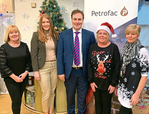 Joanne McBain, second from left, and Dave Blackburn with Aberdeen Foyer employees