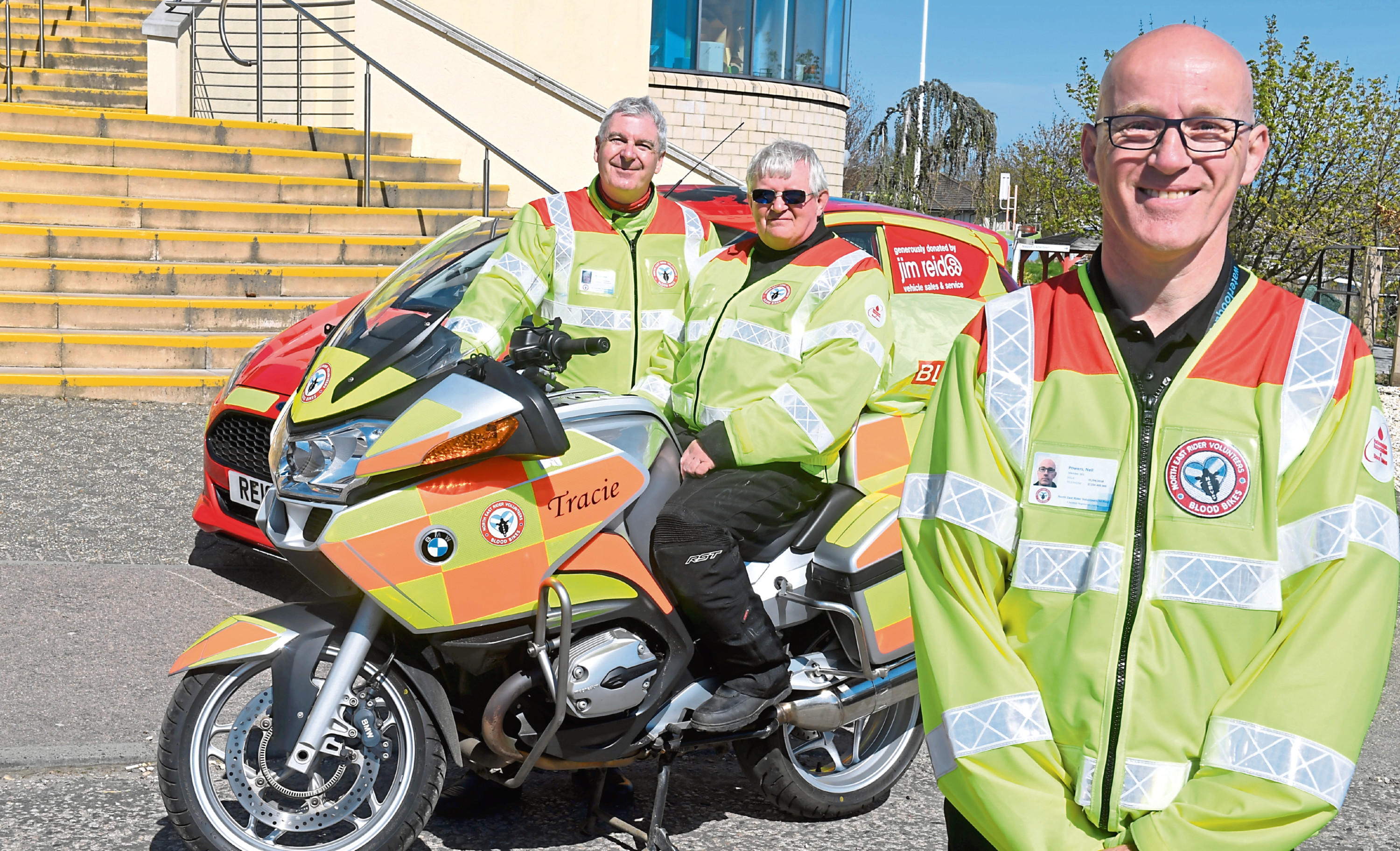 Neil Powers, front, founder and chairman of NERVS, with Dave Barwick, the operations manager, and fleet manager and volunteer rider Graeme Morrice.