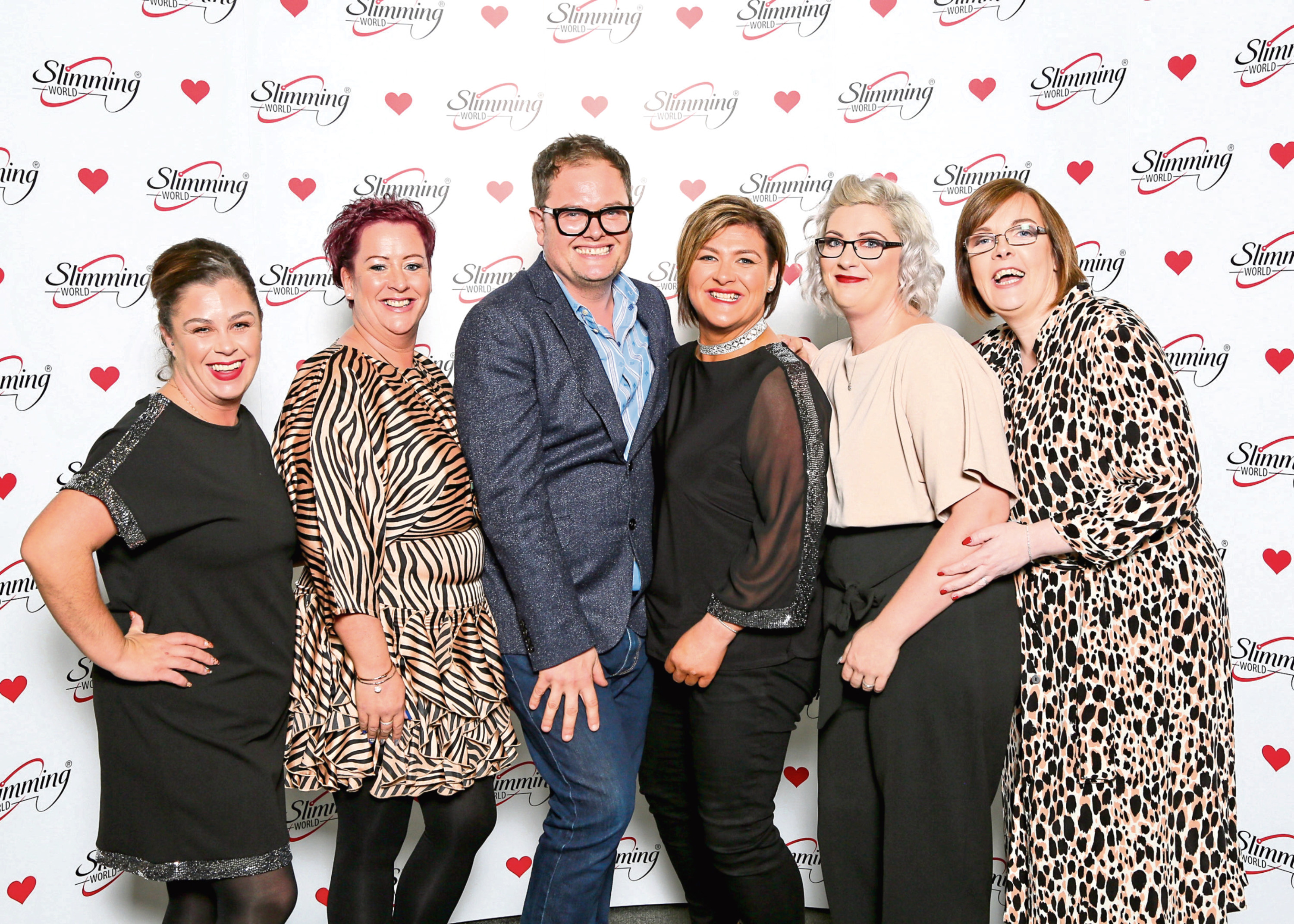 Alan Carr pictured with some of the Slimming World team