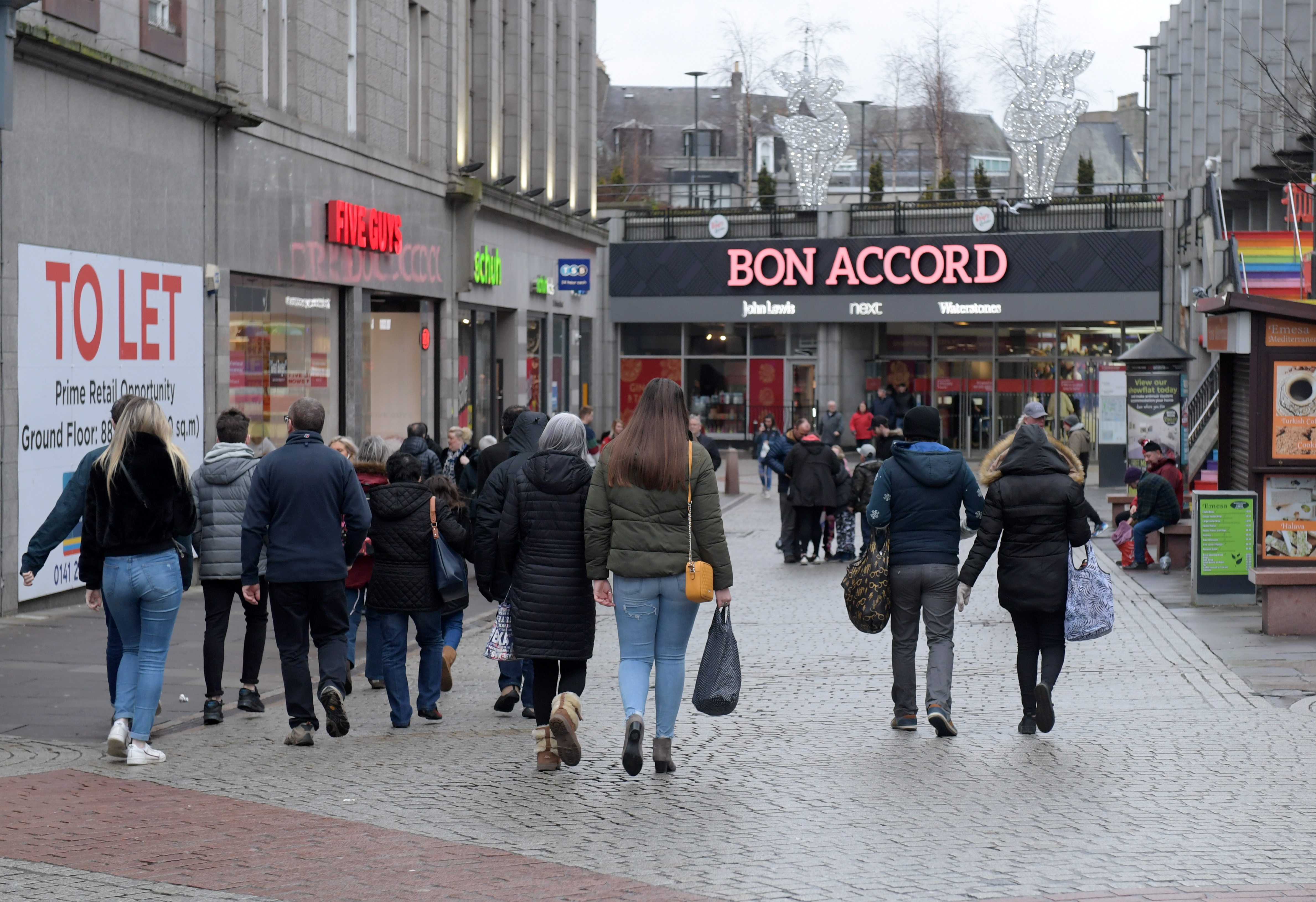 Shoppers outside the Bon Accord Centre