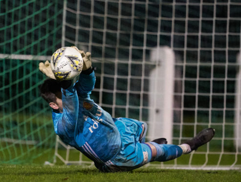 Formartine's Kevin Main saves from a spot-kick.