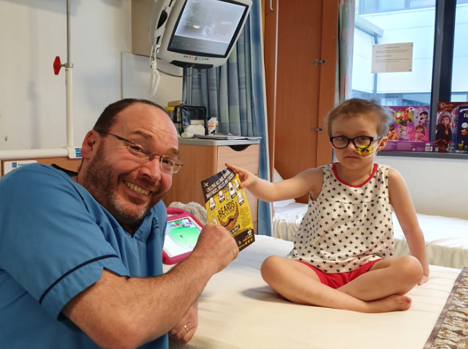 Six-year-old patient Etta nominates senior staff nurse Guy Wilson to grow a beard for Beard for Bairns