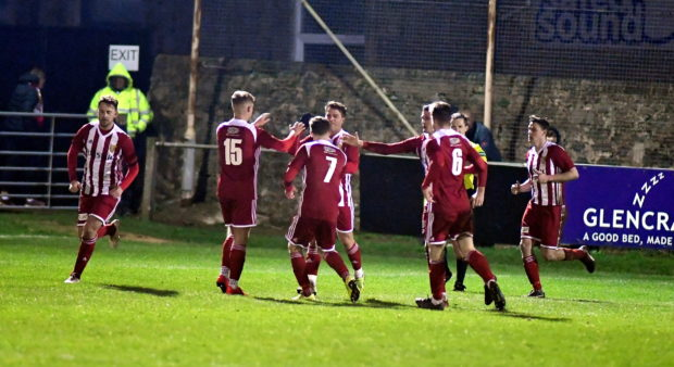 Formartine celebrate an equaliser against Fraserburgh, with Conor Gethins the scorer