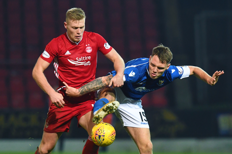Aberdeen's Sam Cosgrove, left.