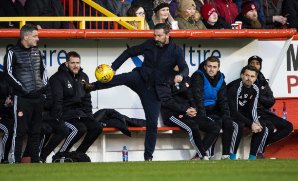 Aberdeen manager Derek McInnes says they can't go into all-out-attack mode.