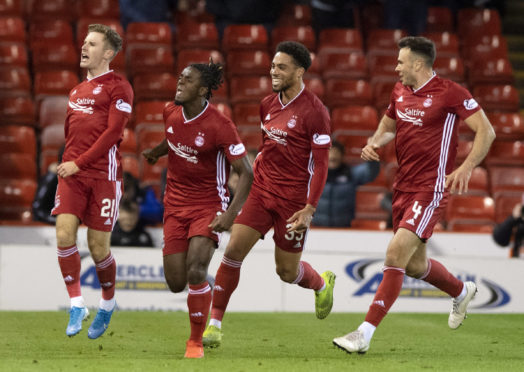 Aberdeen's Jon Gallagher, left, celebrates his goal with Greg Leigh, Zak Vyner and Andy Considine during the Ladbrokes Premiership match between Aberdeen and Rangers at Pittodrie.