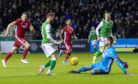 Martin Boyle dinks the ball past Aberdeen's Joe Lewis to make it 1-0 to Hibernian during the Ladbrokes Premiership match between Hibernian and the Dons.