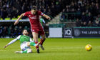 Martin Boyle gets the better of Andy Considine to make it 2-0 to Hibs.