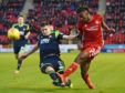 Aberdeen's Greg Leigh, right, is challenged by Hamilton's Aaron McGowan.