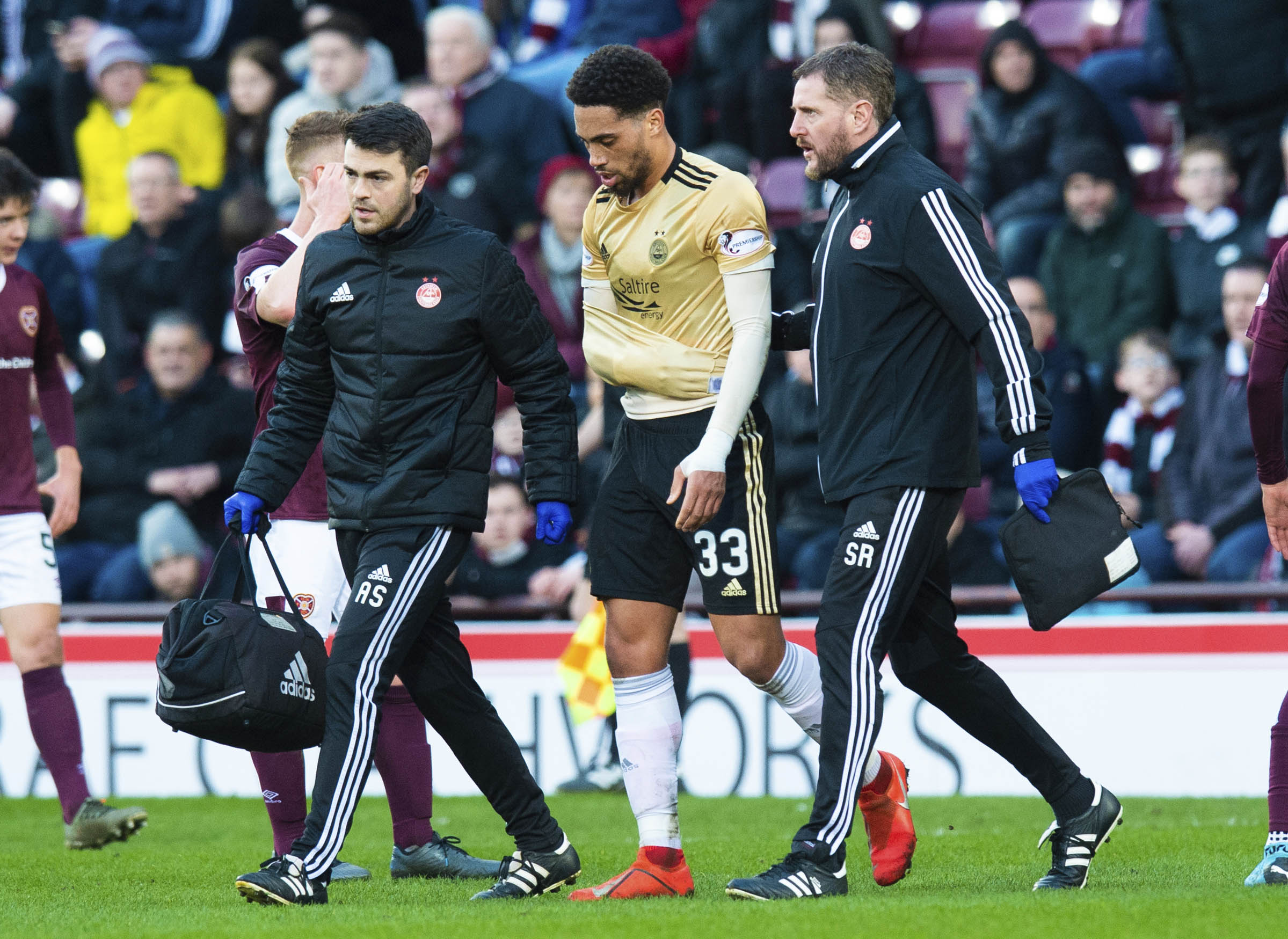 Aberdeen's Zak Vyner goes off with a shoulder injury in the 1-1 draw at Hearts.