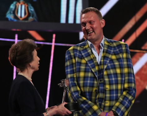 Doddie Weir receives the Helen Rollason Award from The Princess Royal during the BBC Sports Personality of the Year 2019 at The P&J Live, Aberdeen