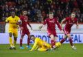 Aberdeen's Lewis Ferguson and Scott Pittman scrap for the ball.