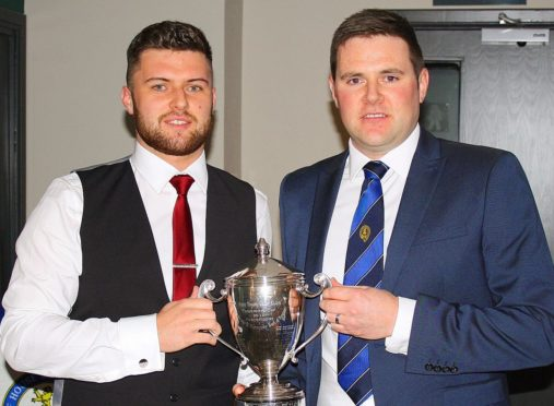 Craig Bain, left, is presented with the Duff House Royal club championship.