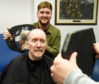 Liam Robertson from Hombre cuts patient James Blair's hair