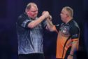 John Henderson wins his second round match against James Richardson during the PDC William Hill World Darts Championship at Alexandra Palace, London.