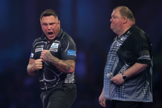 Gerwyn Price (Wales) reacts during his Third Round game against John Henderson (Scotland) during the PDC William Hill World Darts Championship at Alexandra Palace, London.
