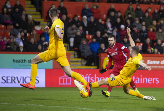 Aberdeen's Connor McLennan makes it 1-0 against Livingston.