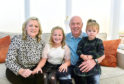 Ian with wife Tracey and grandchildren, Ellie-Beau Feather and Florence Feather