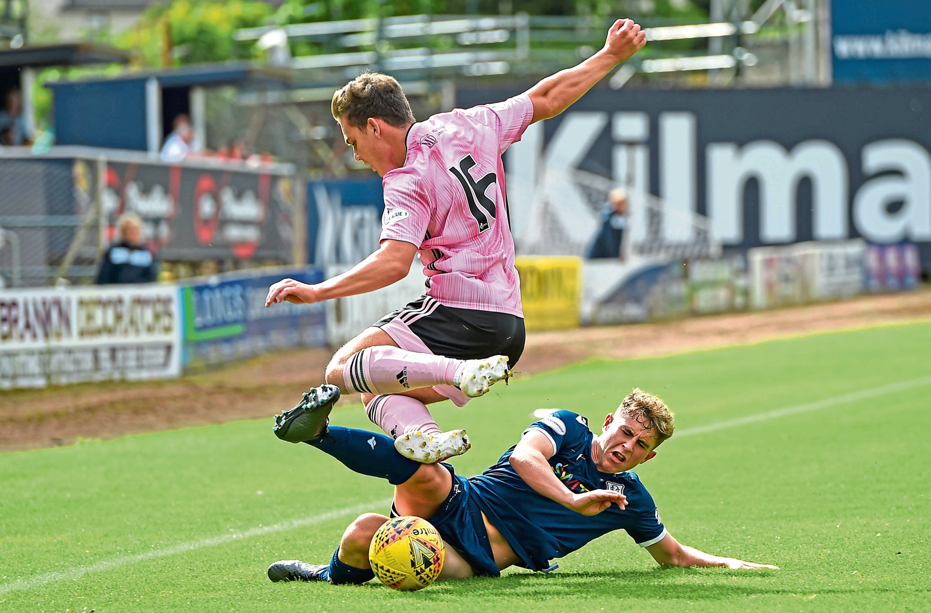 Peterhead's Ben Armour is challenged by Dundee's Finlay Robertson