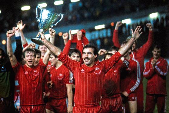 Legendary Aberdeen captain Willie Miller lifts the European Cup Winners' Cup in 1983.