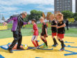 Football legend Denis Law officially opened the Cruyff  Court on Catherine Street