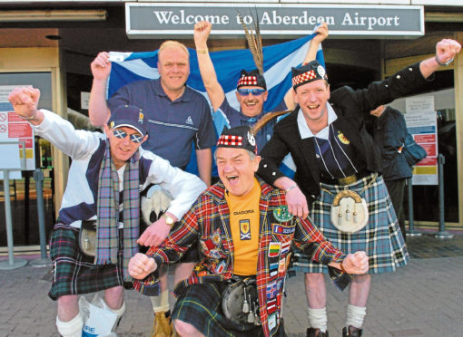 Joe, front, with other Scotland fans at Aberdeen Airport in 2006