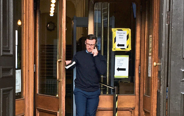 Daniel Higginson leaves Aberdeen Sheriff Court where he appeared for failing to notify police of his new address