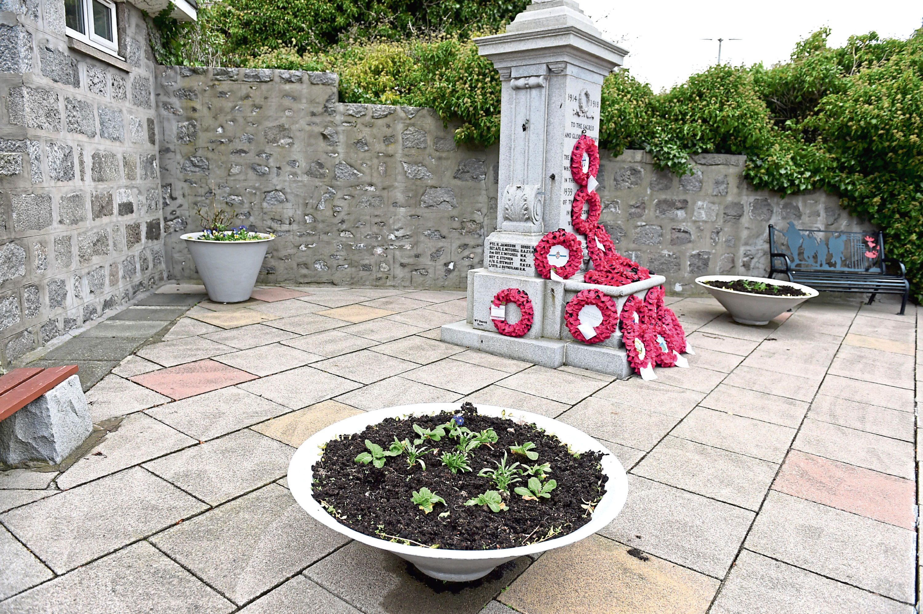 Residents have spoken of their shock after flowers were removed from planters at Bridge of Don memorial