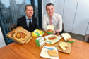 Reporters Dale Haslam and Jamie Hall trying out vegan food from a number of takeaways