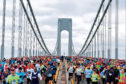 Runners cross the Verrazano-Narrows Bridge at the start of the New York City Marathon, Sunday, Nov. 2, 2014, in New York. (AP Photo/Jason DeCrow)