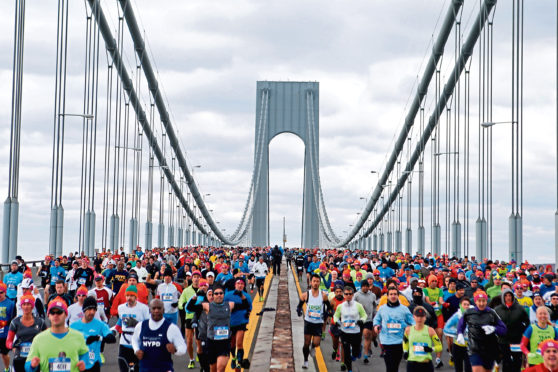 Runners cross the Verrazano-Narrows Bridge at the start of the New York City Marathon, Sunday, Nov. 2, 2014, in New York. (AP Photo/Jason DeCrow)