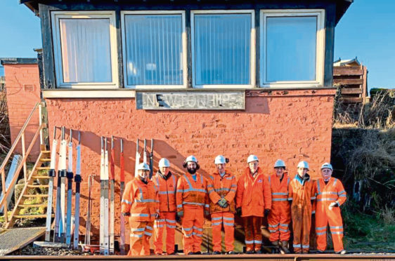 Volunteers from Ferryhill Railway Heritage Trust outside the disused signal box at Newtonhill. Right, Andrew Meff, front, along with some of the team looking to save equipment to put it on display in Ferryhill