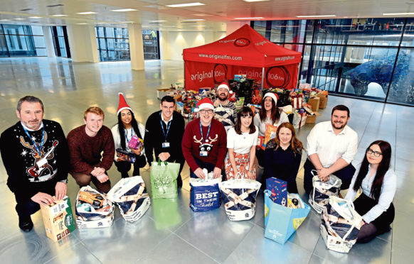 Original 106 and Evening Express staff with some of the donations