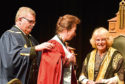The Princess Royal is given her honorary degree by her own sister-in-law the Duchess of Rothesay Pictures by Colin Rennie