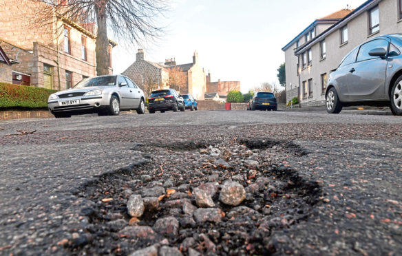 Potholes on Craigie Park, one of the worst-affected streets.