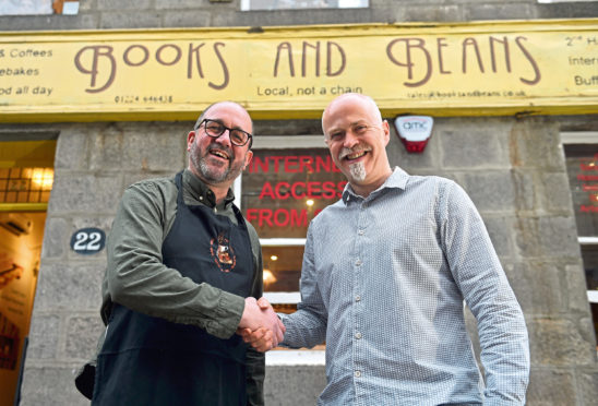 Pictured is new owner John Wigglesworth and former owner Craig Willox outside Books and Beans